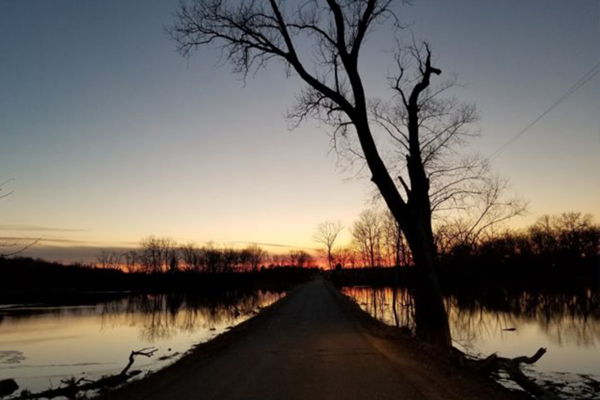 flooded road at sunset