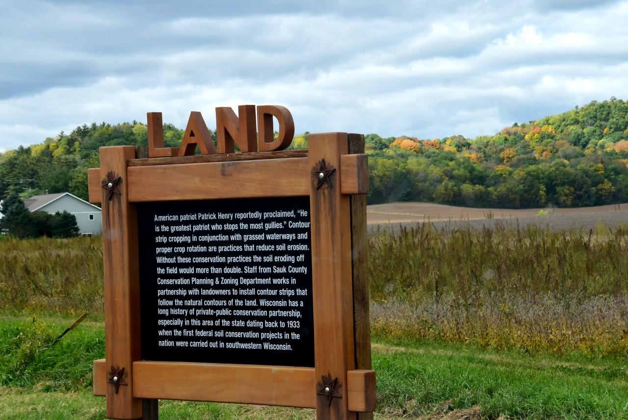 The Land Remembers sign